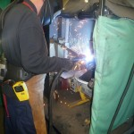 Close up on welding bay and welding fumes